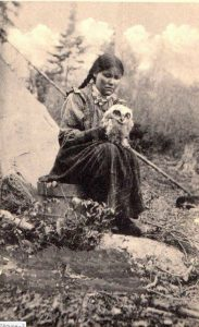 c. 1910s: Indian woman and owl, Blind River, Ontario